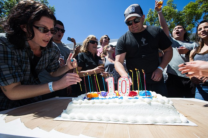 Port Brewing/Lost Abbey brewer Tomme Arthur cuts the cake for his brewery's 10th anniversary. - Image by Davis Gerber