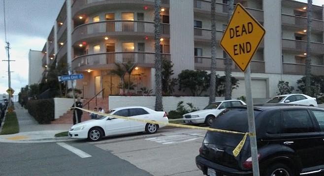 Crime scene tape across Santa Cruz Avenue at Bacon Street