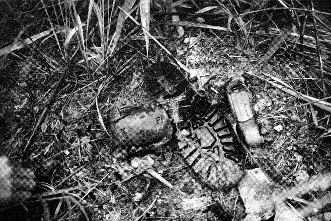 U.S. Marine's jungle boot and fragment of exploded Claymore mine