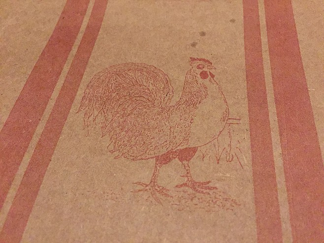 Country-themed chicken stamps on the brown paper atop each table