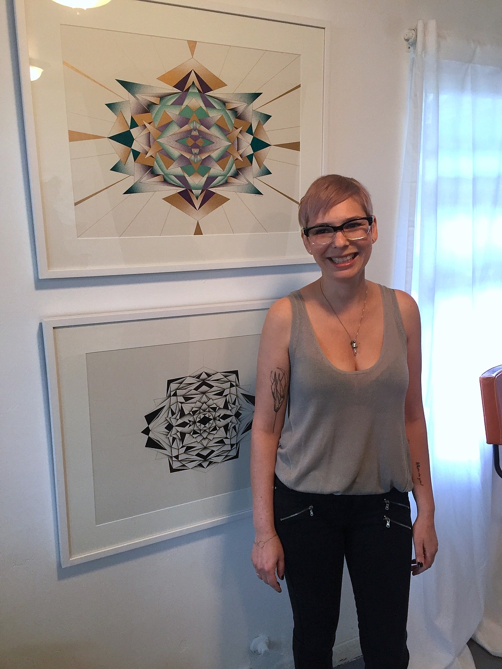 Melissa Walter with two of her pieces in the current exhibit, A New Stellar Order.