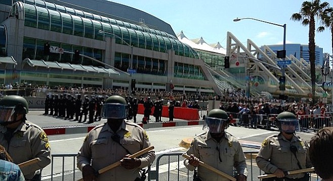 Police and sheriff's deputies attempted to separate protesters from rally attendees as the convention center began to empty.