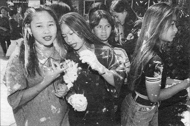 Laotian girl flashes gang sign. The Lao and Cambodian kids of today's gangs never saw the war.