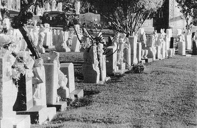Children's gravestones, Holy Cross Cemetery. Mostly, I tell this story for all the burning bad boys and girls out there, all you killers in your khakis and Impalas, all you rucas with your big hair and you dead-eyed young vatos with your little tattoos and mustaches. - Image by Craig Carlson