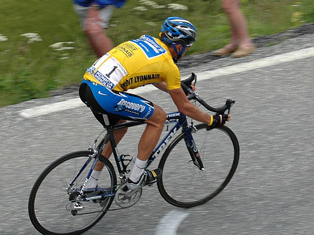 Armstrong wearing the yellow jersey at the 2005 Tour de France. Today is the Tour's first Alpine climbing day, 120 miles long with a rise from 721 to 6,574 feet.