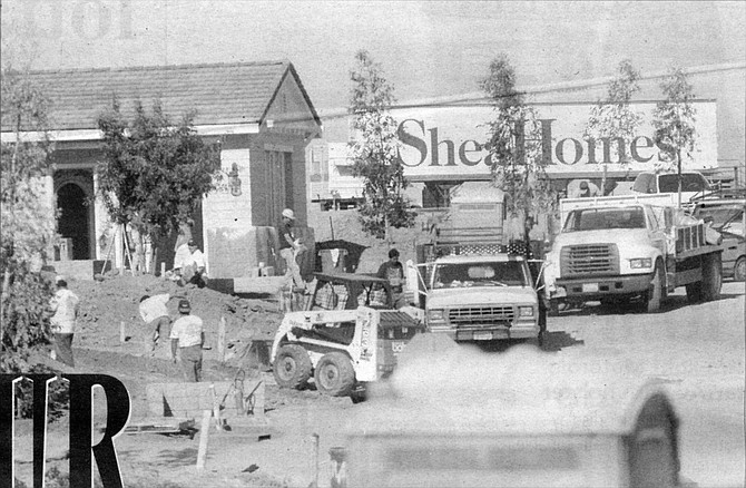 "Construction site of Shea Homes, Encinitas. The sign at Via Cantebria that, in early 1998, advertised homes selling ""from the high three hundreds"" now said ""from the mid-four hundreds.""  - Image by Sandy Huffaker, Jr."