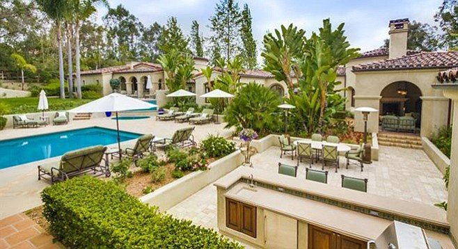 No flat screens mentioned, but the pool area touts a sun deck, dining patio, and outdoor kitchen.