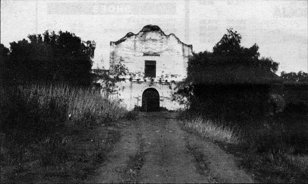 Mission San Diego de Alcala. I found the best crossing to be almost directly beneath the I-15 overpass; I paused on the muddy banks, littered with freeway trash and speckled with possum tracks. I rolled up my pants legs, then slogged on through the knee-high water.