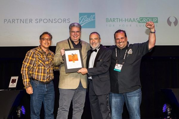 The Novo Brazil team accepts their bronze medal in the British-style imperial stout category at the 2016 World Beer Cup.