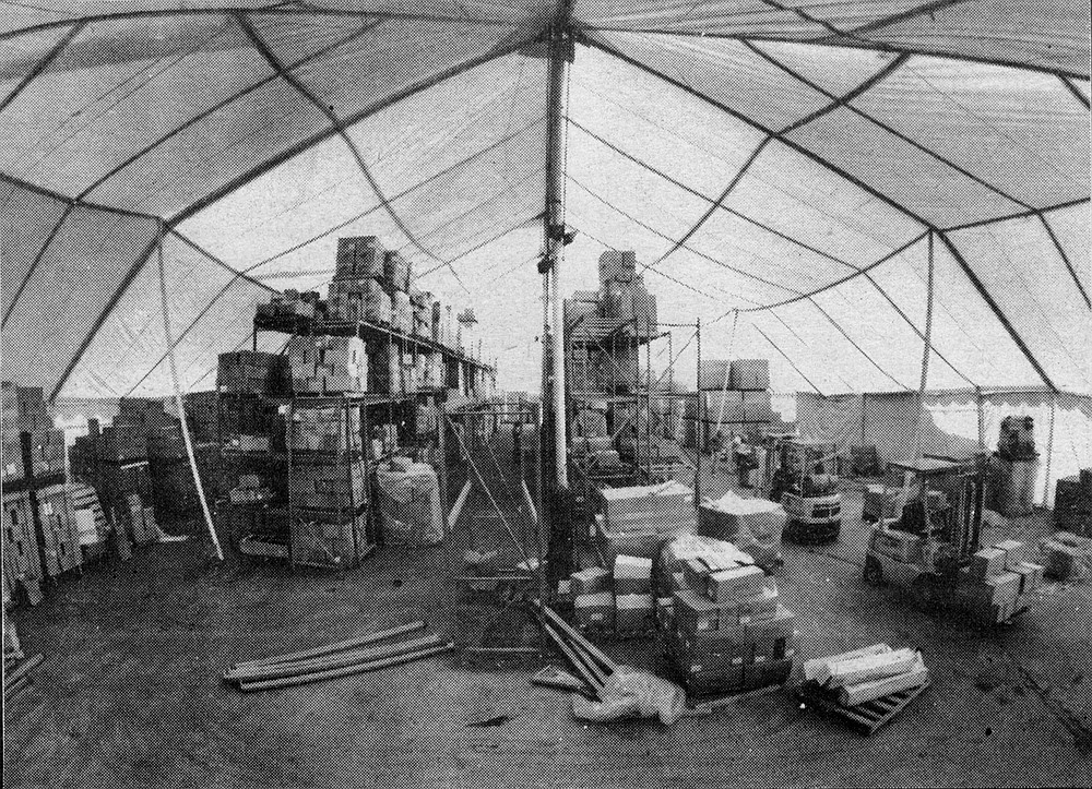 The tent and a fleet of sixty storage trailers hold completed computers and the electronic components from which they are built.