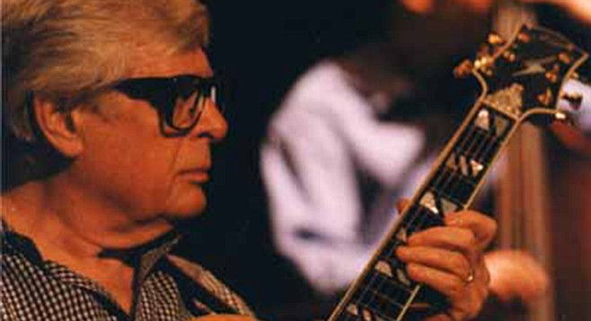 Mundell Lowe favors one note where other guitarists might play ten. Or a hundred and ten.