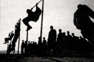 Young recruits swing from ropes, clamber up walls, and run across narrow logs.