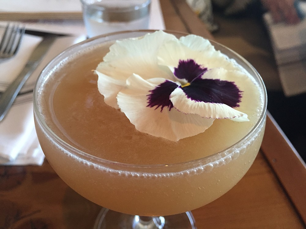 A flower-adorned cocktail