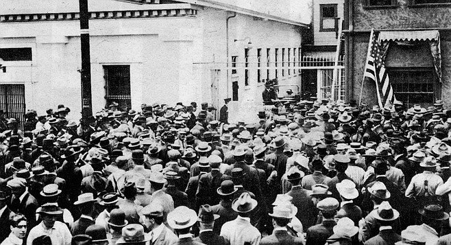 """Anti-wobbly demonstrators in front of old police station. """"When my brother finally got back some months later, he said that what the police and vigilantes did in San Diego was the worst head busting he'd ever seen."""""""