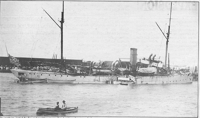 The gunboat, gutted by fire and scalding steam, lists beside a downtown dock. The sudden influx of sea water increased the list to starboard and alarmed Gauthier and the other sailors who had survived the blast but were trapped in compartments of the ship.