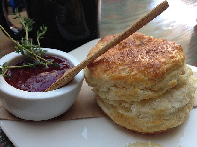 A terrific biscuit and tasty jam, served with an adorable small wooden spoon