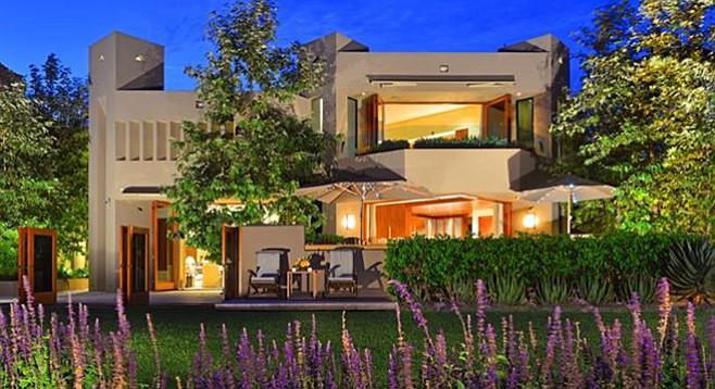 "A ""magical master bedroom"" has retractable doors that open onto a balcony."