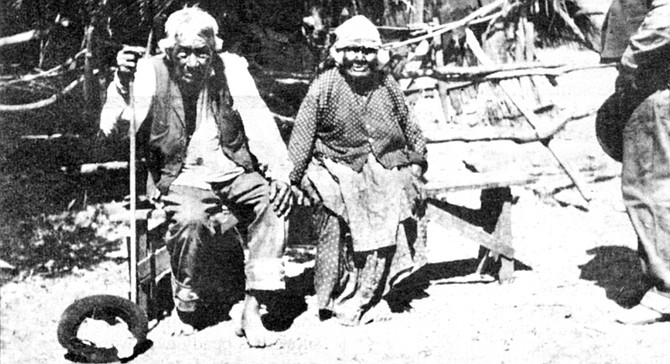 "Indian couple, 1910. ""Many of our boys and young men left us to go where the whites went, never to return."""
