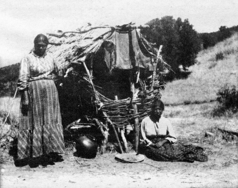 """Susana and Madelina, Volcan Mountain; 1909. """"We fled into the fastnesses of the mountains high up among the tall trees and there waited for the north wind to bring snow."""""""