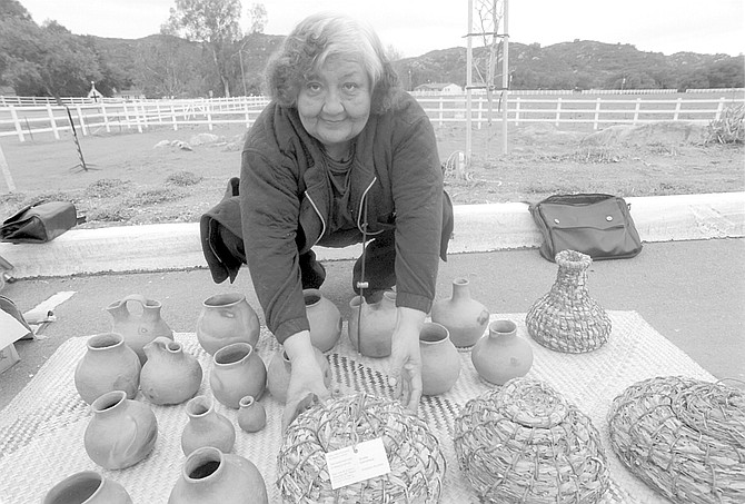 Gloria Castañeda. When her relative Petra started making baskets, sumac was the weft, and the bundle was made of deer grass, but the overgrazing of the late 1800s took away the deer grass. - Image by Sandy Huffaker, Jr.