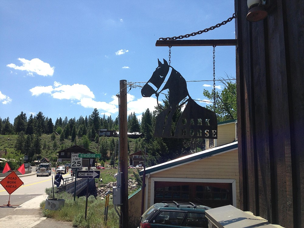 This sign for San Diego company Dark Horse Coffee Roasters hangs outside its shop in the Sierra Nevadas