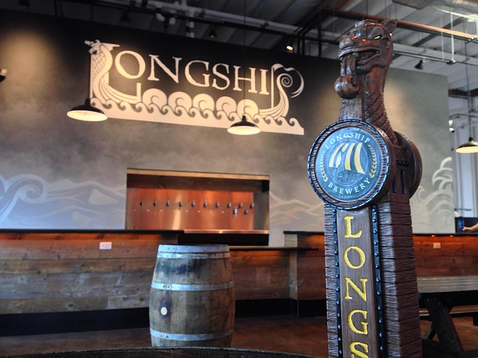 Hand-carved tap handles resemble the dragons on the bows of Viking vessels at Longship Brewery.