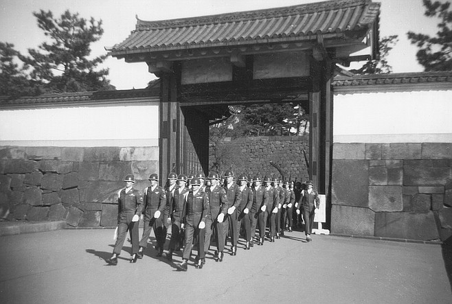 "MacArthur's honor guard, Tokyo. ""We wore tailored uniforms and blue silk scarves we tucked into our collars, and we had special things in the legs of our pants to keep the creases straight."""