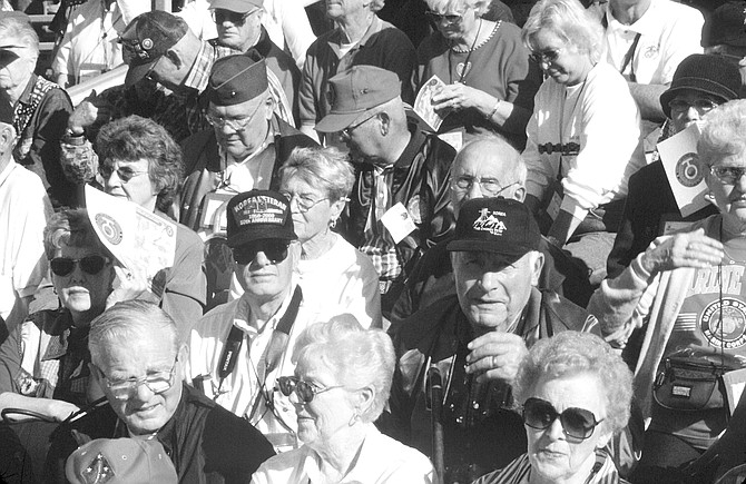 Korean war veterans and their spouses at Camp Pendleton, December 2000. The crowd thundered its approval with applause, whistles, and the Devil Dog growl.