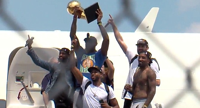 Members of the victorious 2016 Cavaliers basketball team do their best to ignore the gnawing emptiness tearing at their souls as they arrive in Cleveland following a thrilling seven-game NBA Finals against the Golden State Warriors. Most poignant is star LeBron James' sad effort to make a golden trophy obscure the fact that his quest to bring home a championship is over and nothing remains except the terrifying prospect of repetition, with ever-diminishing returns.