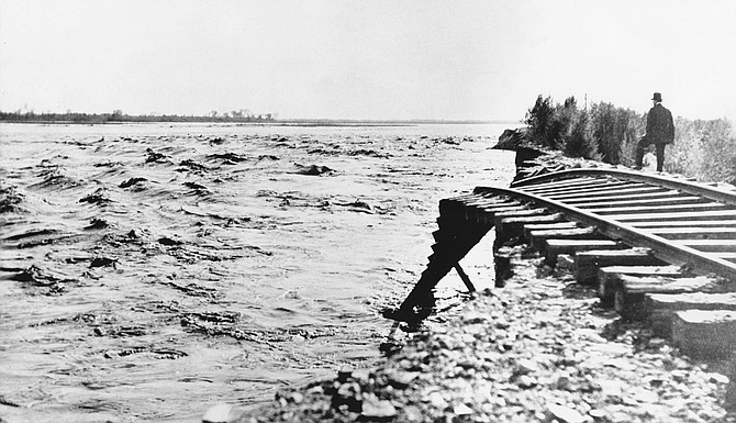 Imperial Valley, 1905. Dynamite strapped to his back, Meadows dogpaddled downstream, dodging everything from angry rapids and tree trunks to dead animals.