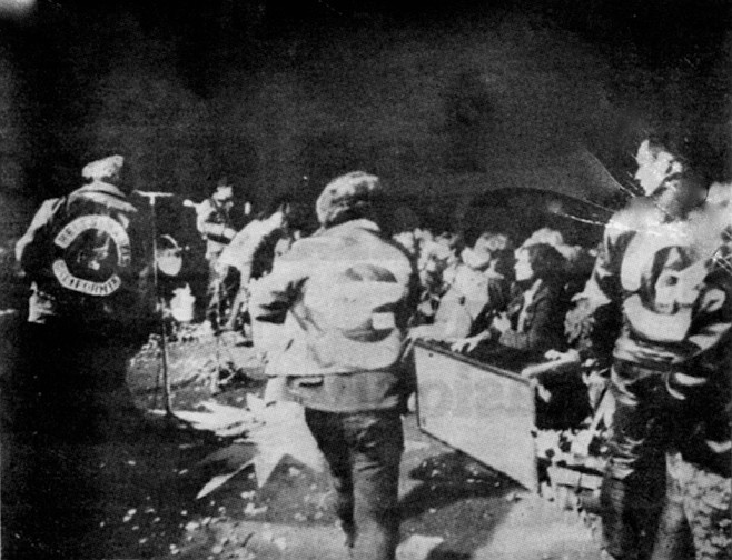 """Security trying to manage the crowd at Altamont Speedway. """"I can't do any more than ask you to keep it together."""" Mick again, sounding the conciliatory note. """"If we're all one, let's show we're all one!"""""""