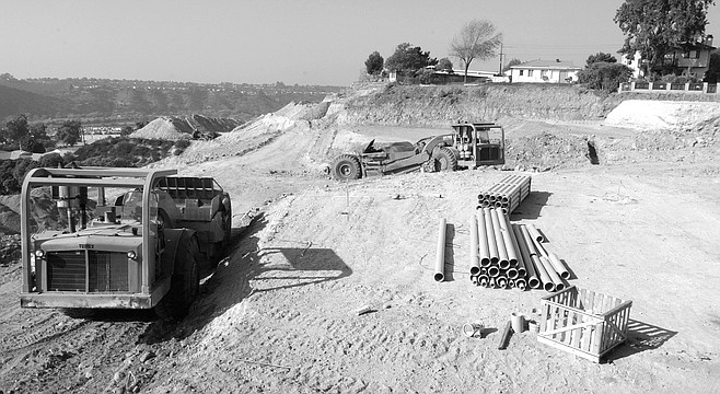 Development of Halifax. Bulldozers are grading land into terraces on which will sit 25 new homes.