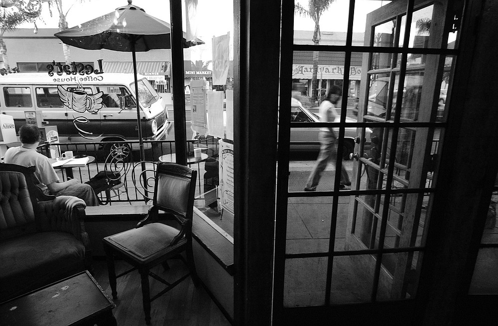 "Adams Avenue, from inside Lestat's. ""It seemed that three out of every five homes south of Adams Avenue in Normal Heights were in the process of being remodeled or had already been remodeled."""