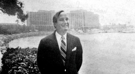 Armand: Here is a picture of Mr. Roberts, the hotel's manager. He's standing beside the marina with the Sheraton in the rear. --E.