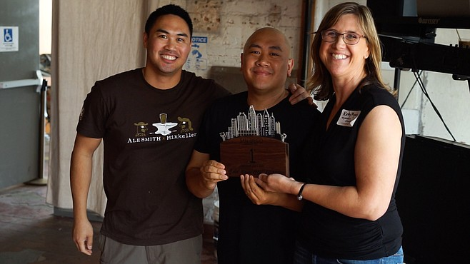 RJ Ocubillo and Mike Arquines accept one Mostra Coffee's Cold Brew City trophies from San Diego Coffee Network Event Director Kathy Myers.