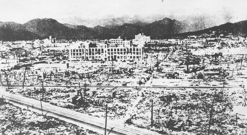 """Hiroshima, one mile from ground zero. """"We could see that rubble for the most part had been reduced to powder and sucked up into the cloud, just as had so many of the former inhabitants of Hiroshima."""""""