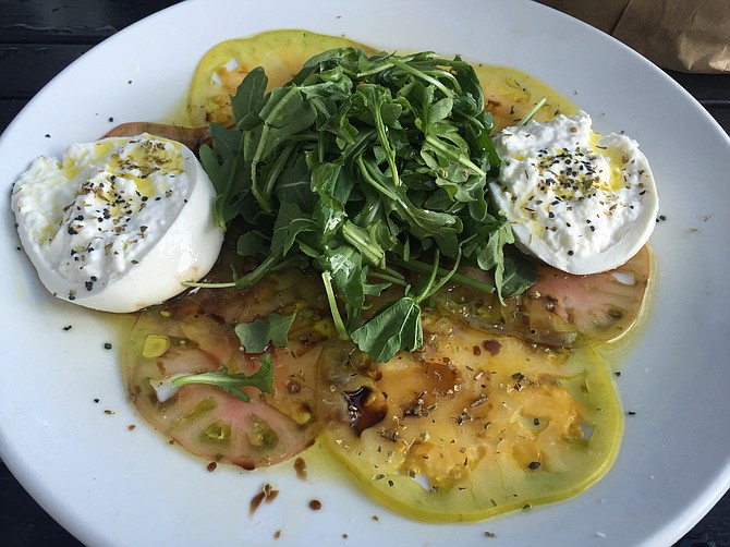Caprese salad with heirloom tomatoes and burrata cheese