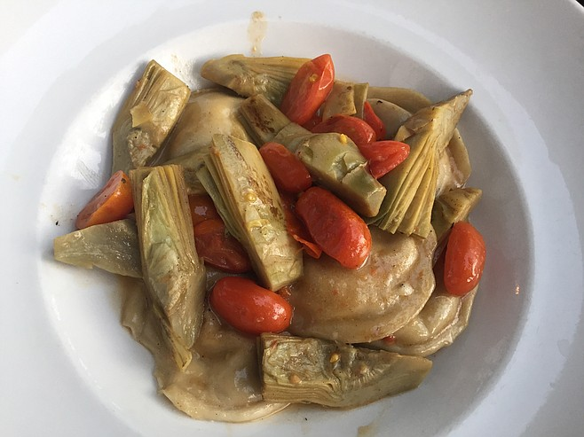 Ravioli with smoked cheese, served with artichokes
