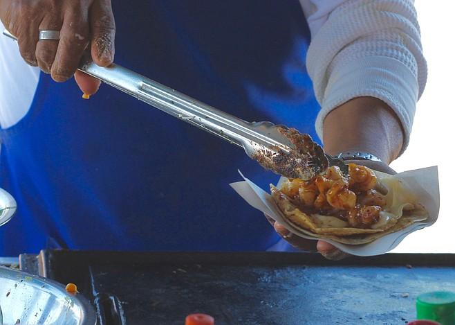 Preparing the shrimp enchilado