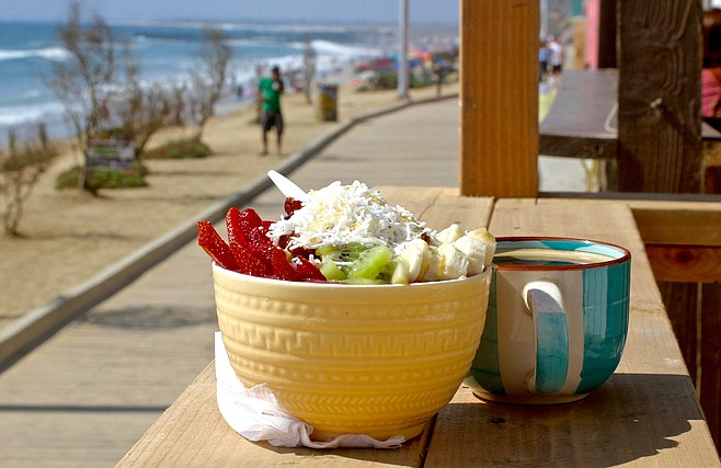 Tropical açai bowl and coffee with ocean view