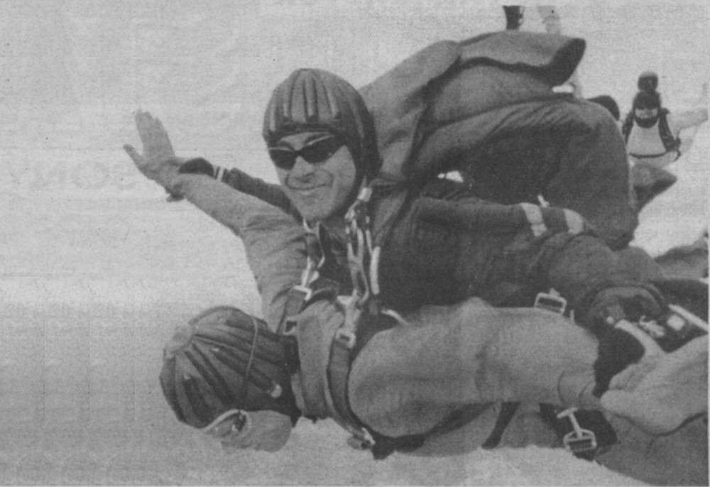 "The author (face down) and Tim Ige. ""I grab my jumpsuit, where I think the ripcord handle should be, but it's not there."""