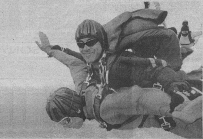 """The author (face down) and Tim Ige. """"I grab my jumpsuit, where I think the ripcord handle should be, but it's not there."""""""