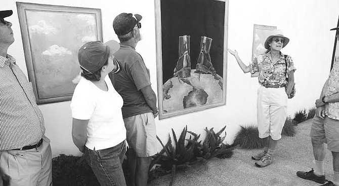 """Patricia Fares (right) at ReinCarnation building. """"The artists keep moving to where they can afford to live. But then the original people, who were the draw, are driven out."""" - Image by Dave Allen"""