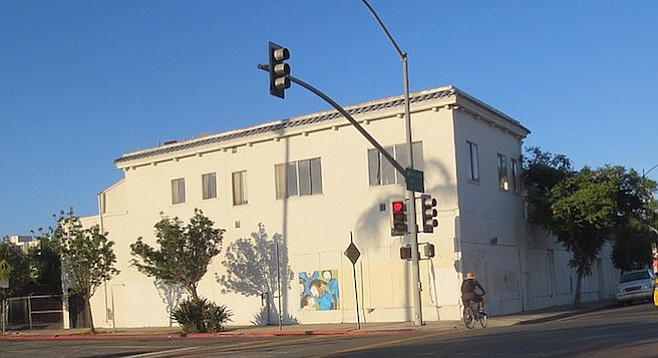"""The Sally Wong building (4102-4122 University). """"We do murals partly to avoid graffiti,"""" says a City Heights Business Association boardmember."""