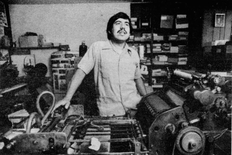 Herman Baca in his shop. It's certain that his business is slow. He seldom prints more than half a day at a time.