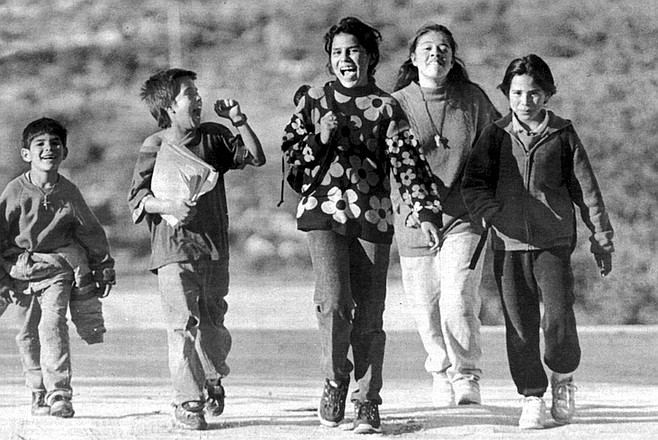 Kids walking home from school, Jacumé. Citizens of each country have been free to cross the border whenever they wished. Mexicans have gone north to pick up their mail at the Jacumba Post Office, shop, find casual work.