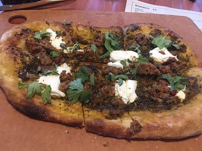 Merguez, chermoula, and labneh pizza