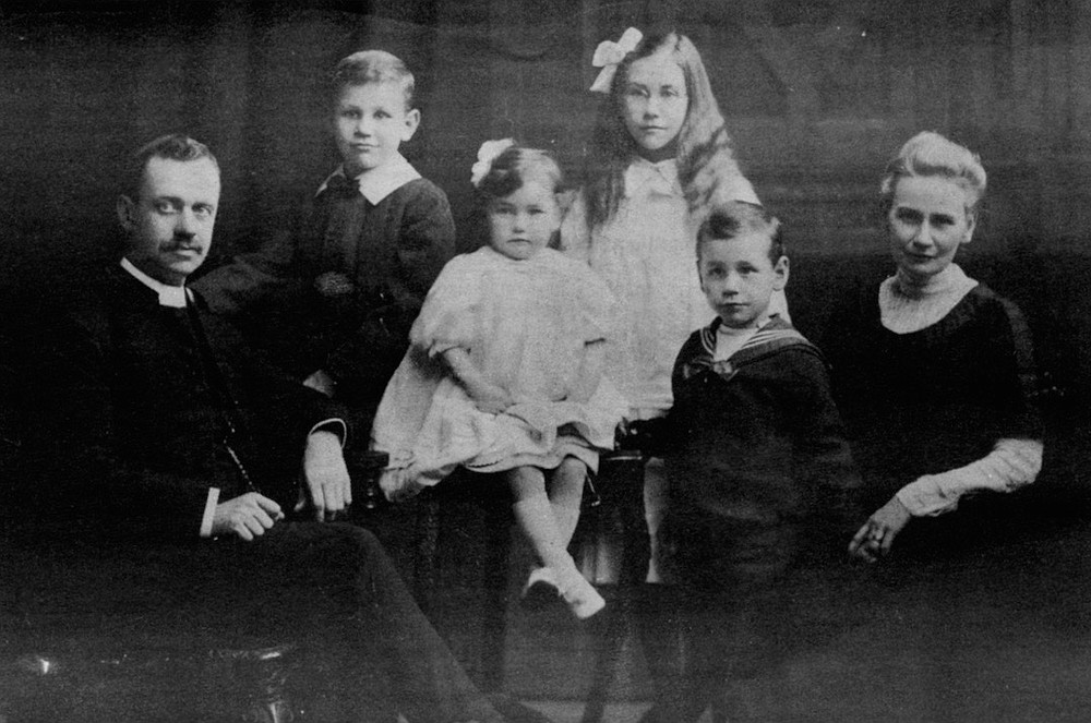 Family portrait, John on right (ca. 1911). Theobald became a classmate of Eric Liddell, the champion sprinter portrayed in the movie Chariots of Fire.