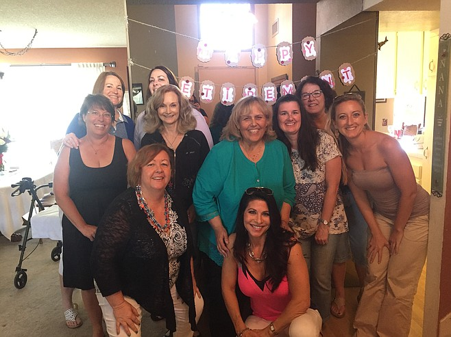 My mom with coworkers at her retirement party