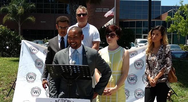 Chris Garnier, flanked by Rev. Shane Harris (left) and Kimberly Garnier (right)
